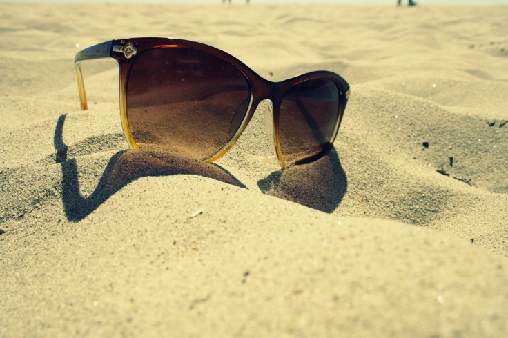 Brown sunglasses on the beach