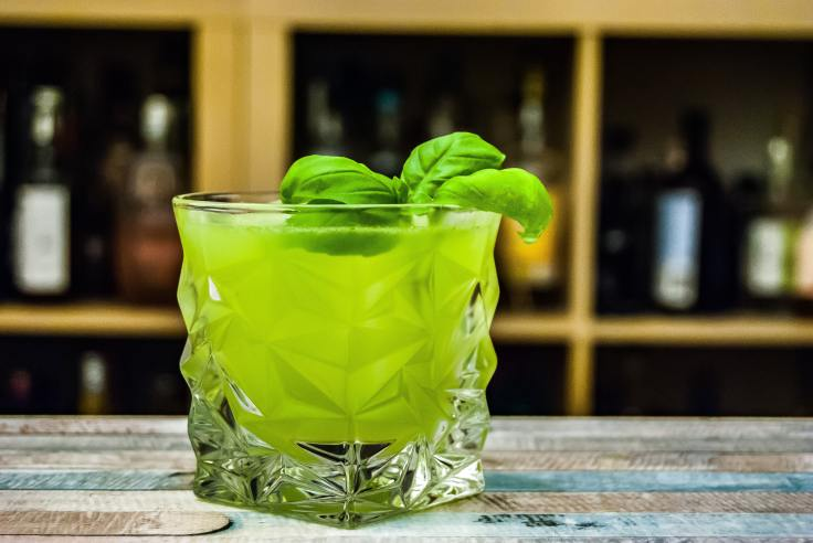 Cocktail Gin Basil Smash on a table with basil leaf